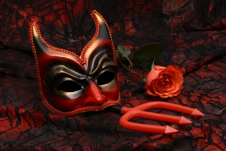 devil mask and red rose